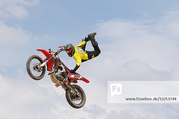 Motocross racer jumping in the air