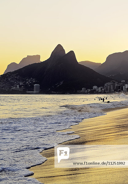 Brazil  City of Rio de Janeiro  Ipanema Beach and Morro Dois Irmaos during sunset.