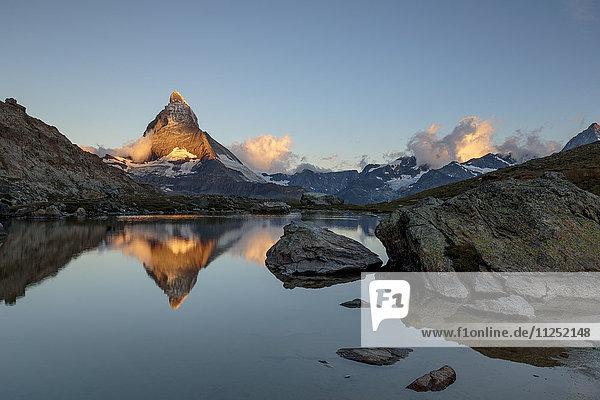 Matterhorn with Lake Riffel at dawn Valais Switzerland Europe.