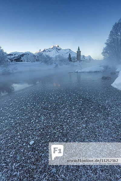 Foggy sunrise in winter. Sils Maria  Sils im Engadin  Graubunden  Switzerland.