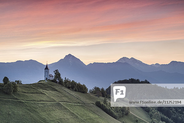 Europe  Slovenia. Church of St Primus and Felician in Jamnik in the early morning