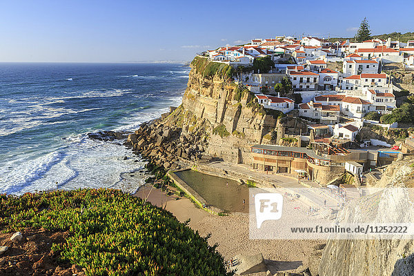 Top view of ocean waves crashing on the high cliffs of Azenhas do Mar Sintra Portugal Europe