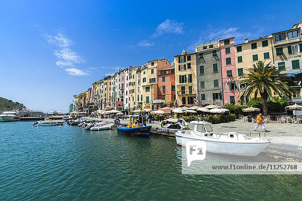 The turquoise sea frames the typical colored houses of Portovenere  UNESCO World Heritage Site  La Spezia province  Liguria  Italy  Europe