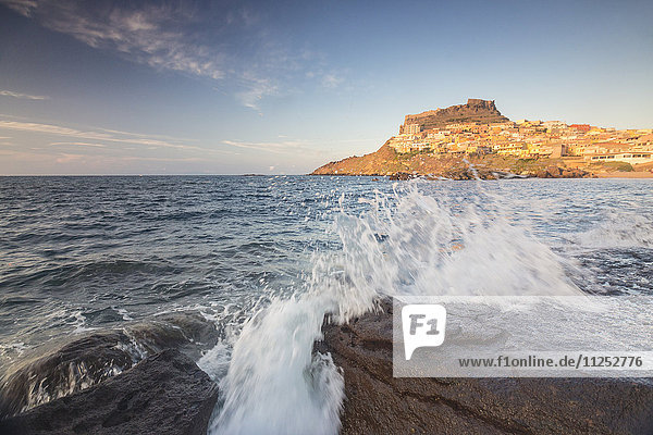 Waves of blue sea frame the village perched on promontory  Castelsardo  Gulf of Asinara  Province of Sassari  Sardinia  Italy  Mediterranean  Europe