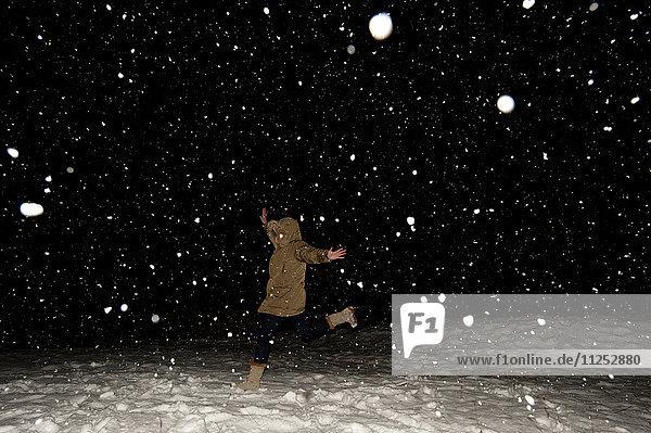 Snowfall at night lit up by a flashgun  Falcade  The Dolomites  Italy  Europe