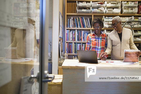 Women using laptop in office