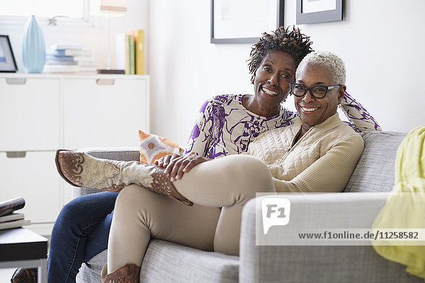 Portrait of smiling women sitting in living room