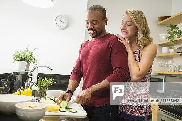 Couple preparing dinner in kitchen