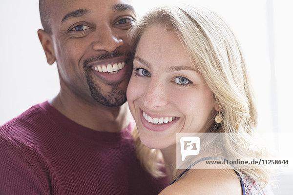 Portrait of happy multi ethnic couple