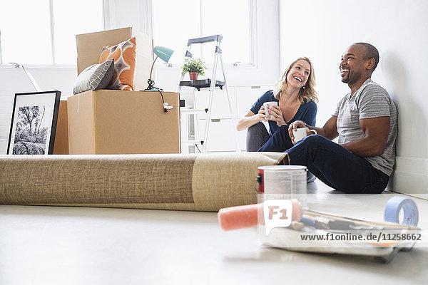Multi ethnic couple in new apartment