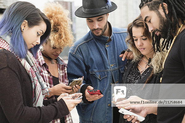 Young people outdoors using smartphones