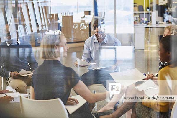 Business people reviewing paperwork in meeting