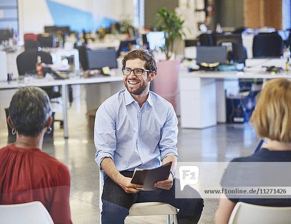 Businessman smiling in meeting