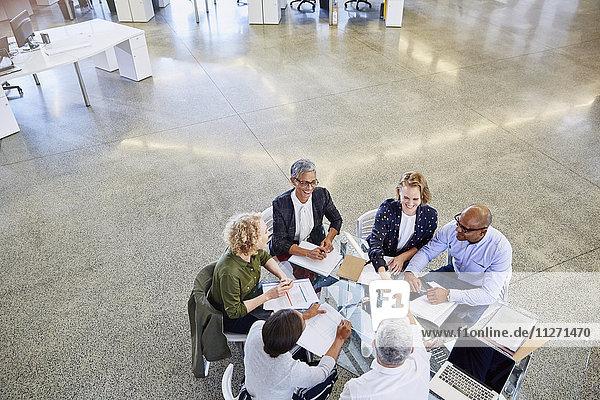 Business people handshaking in meeting