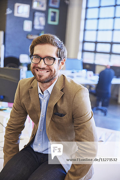 Portrait smiling businessman in office