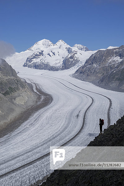 Caucasian hiker on snowy road  Aletsch Glacier  Canton Graubunden  Switzerland