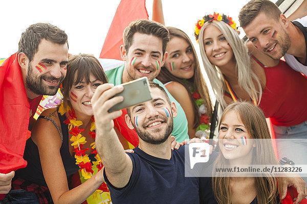 Group of soccer fans taking a selfie