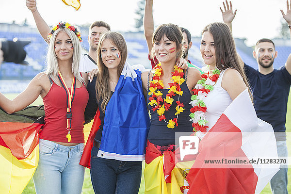 Group of soccer fans with different national flags