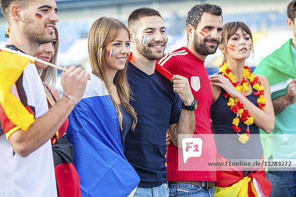 Soccer fans with different national flags