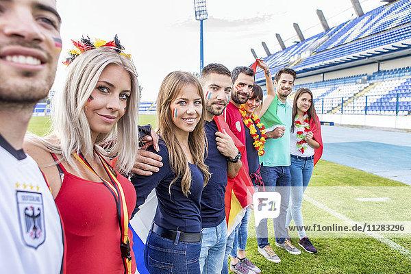Group of fans on soccer field