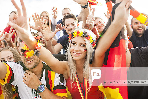 Group of German soccer fans cheering