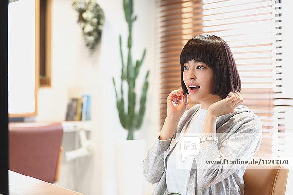 Young Japanese woman at a hair salon