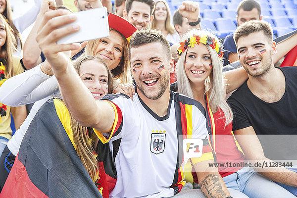 Group of German soccer fans taking a selfie