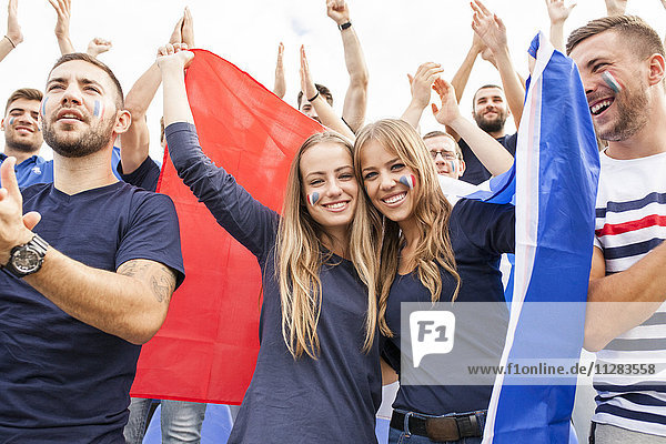 Soccer fans with French flag celebrating