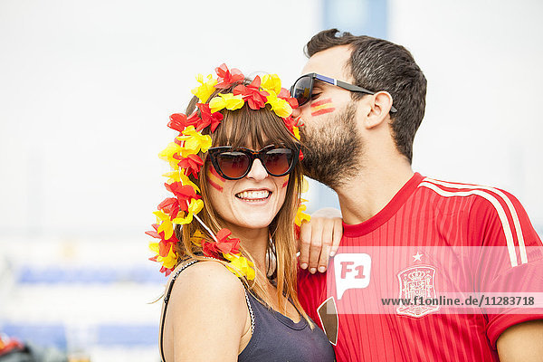 Young Spanish couple with face paint and floral garland