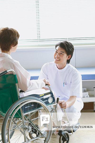 Japanese nurse with patient