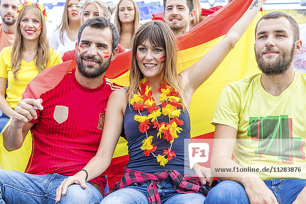 Group of soccer fans with Spanish flag
