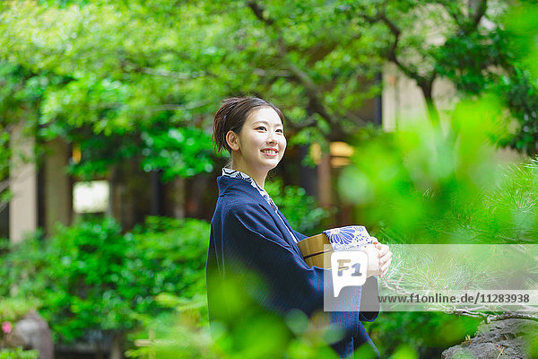 Young Japanese woman wearing yukata at traditional onsen hot spring