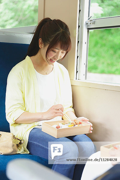 Young Japanese woman on a train trip