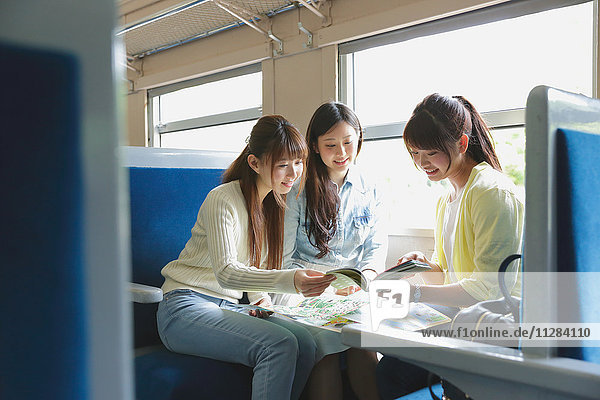 Young Japanese women on a train trip