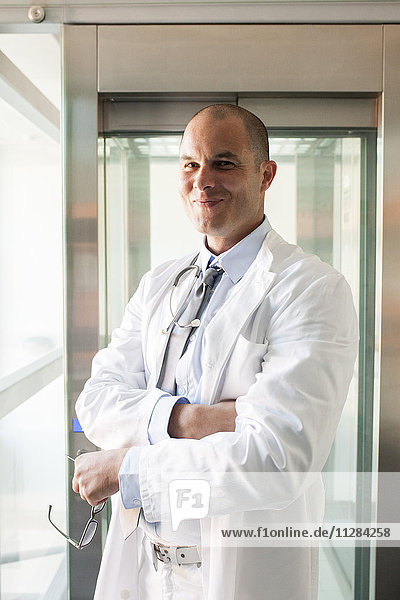 Portrait of male doctor with arms crossed