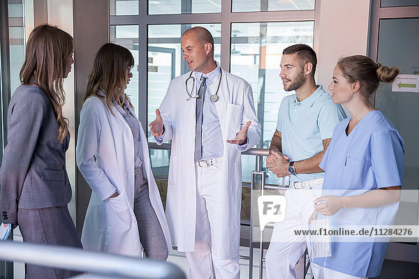 Doctor talking to his team in medical clinic