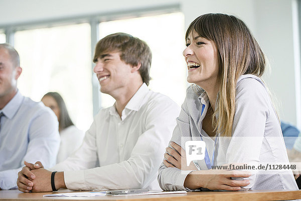 Healthcare workers in training class laughing