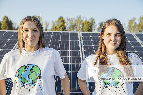 Teenage environmentalists in front of solar panels