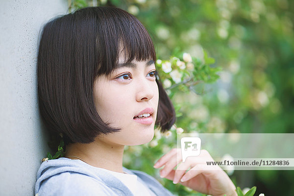 Young Japanese woman portrait outside
