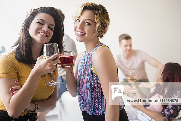 Portrait of smiling women toasting at party