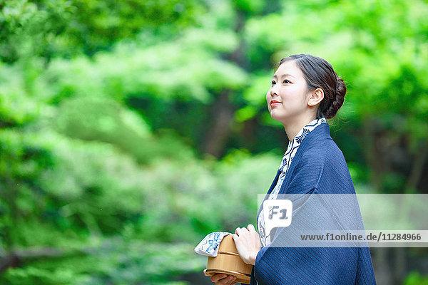 Young Japanese woman wearing yukata at traditional onsen hot spring