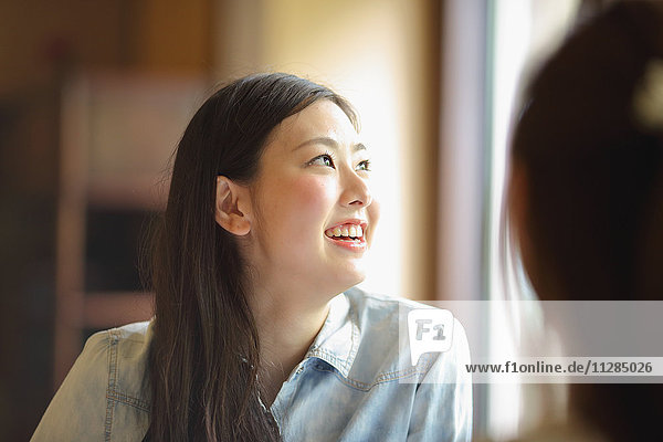 Young Japanese woman eating at traditional restaurant