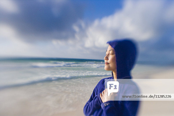 Japanese woman relaxing on beach
