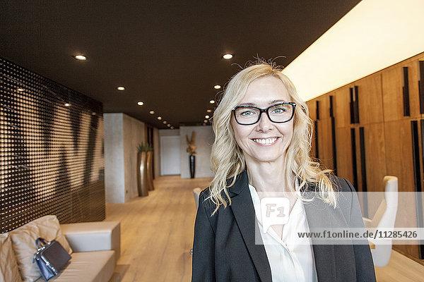 Portrait of businesswoman in lobby