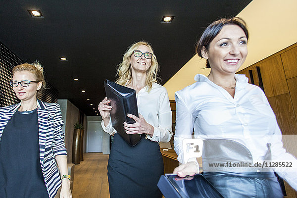 Group of businesswomen walking in lobby
