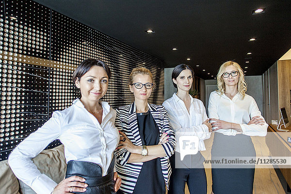 Group of businesswomen standing in lobby