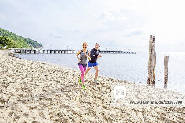 Couple jogging along the beach