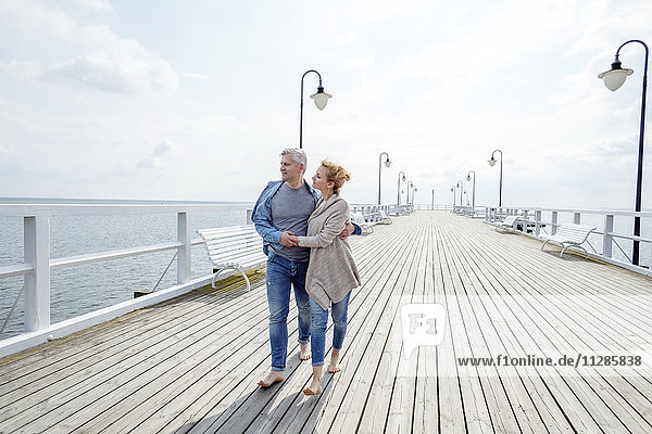 Couple taking a walk along the jetty