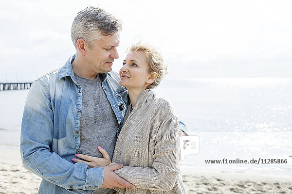 Couple in love embracing on beach