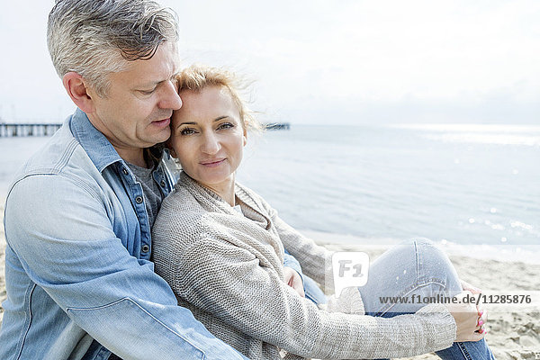 Portrait of couple in love relaxing on beach